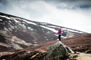 Steph taking in the dramatic views through Glen Callater along Jock's Road. Invercauld Estate, Cairngorms National Park, Scotland.