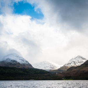 Wearing a blanket of late spring snow, the Arrochar Alps (left to right, A'Chrois, Beinn Ime, Ben Vane) cut an imposing figure above Loch Lomond.