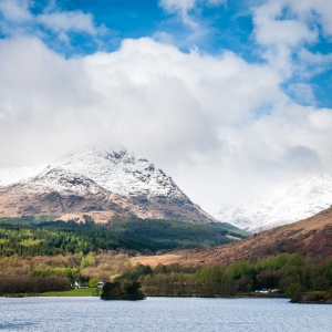 Snow-capped A'Chrois towers above the deep blue waters of Loch Lomond.