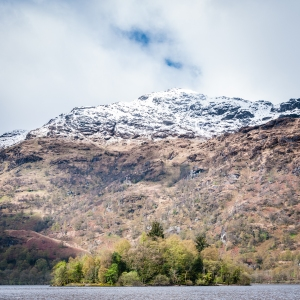 The snow-capped ridge of Ben Vorlich dwarfs a small island in the northern reaches of Loch Lomond.