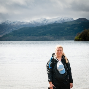 Finally at the northern end of Loch Lomond, Steph takes a minute to enjoy the fleeting sunshine before continuing on the West Highland Way.