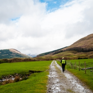 Steph cruising through the pastures of Auchtetyre on the West Highland Way.