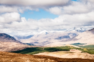 A fine combination of clouds and soft sunshine illuminates the stunning Scottish scenery along the West Highland Way.