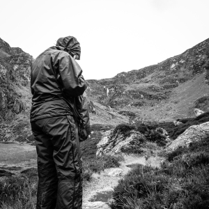 Glistening wet rain gear is a hallmark of summer hiking in Scotland.