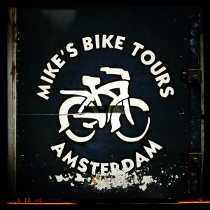 It's a sign. For Mike's Bike Tours. In Amsterdam. Illustration. Get it?
