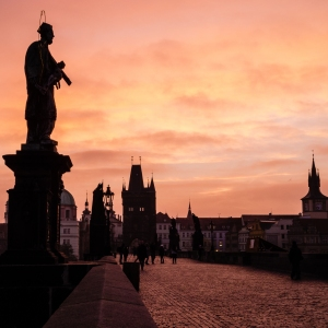 Sunrise over Prague's famous Charles Bridge.